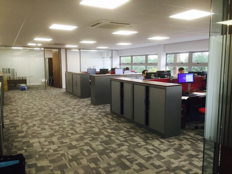 Office Desk Arrangement With Tambour Door Cupboards